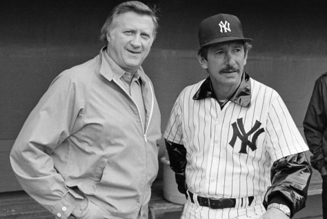 In this March 1, 1983, file photo, New York Yankees owner George Steinbrenner, left, and manager Billy Martin, get together outside the dugout at baseball spring training in Fort Lauderdale, Fla. Steinbrenner will be on the Hall of Fame veterans committee ballot next month with Martin. Steinbrenner owned the Yankees from 1973 until his death in July, and the team won seven World Series championships, 11 AL pennants and 16 AL East titles during his turbulent and blustery reign. Martin had five stints as Yankees manager under Steinbrenner, who fired him four times and let him resign once. (AP Photo/Ray Howard, File)