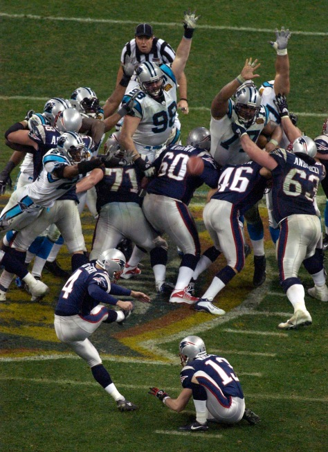 The Patriots' Adam Vinatieri kicks the game winning field goal Sunday night Feb. 1, 2004 during Superbowl XXXVIII. They beat the Carolina Panthers 32-29. 2/1/04 (STEVE CAMPBELL, STAFF/HEARST NEWSPAPERS - HOUSTON CHRONICLE)
